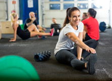 Woman Doing Stretching Exercise At Cross Training Box