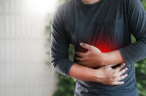 MAN with symptomatic acid reflux , suffering from acid reflux