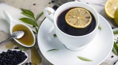 A cup of tea, honey, and lemons. Elderberries.