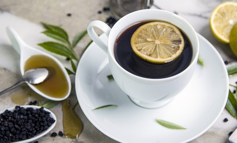 A cup of tea, honey, and lemons. Elderberries.