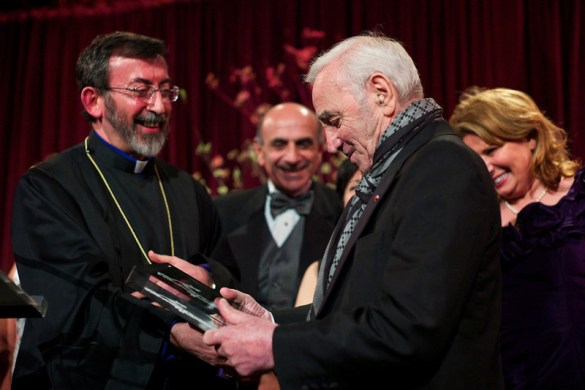 Archbishop Khajag Barsamian presents an award to Charles Aznavour as members of the Fund for Armenian Relief Board of Directors look on. (photo credit: Edmond Terakopian).
