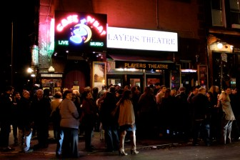 The sold out crowd waiting outside The Players Theatre before the show