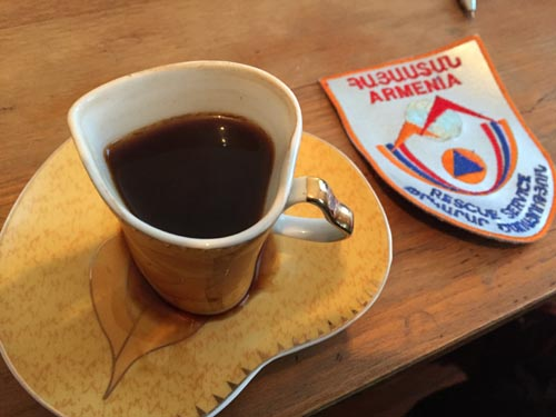 The heart shape cup of coffee and Armenian Fire patch