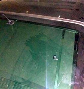 Bullet dent on the car rear window