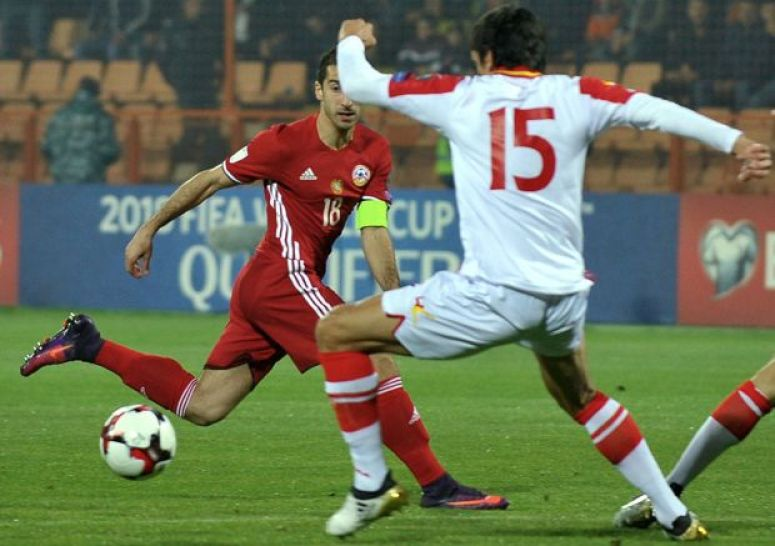 Armenia's Henrikh Mkhitaryan (L) and Montenegro's Stefan Savic vie for the ball during the WC 2018 football qualification match between Armenia and Montenegro in Yerevan on November 11, 2016.  / AFP / Karen MINASYAN        (Photo credit should read KAREN MINASYAN/AFP/Getty Images)