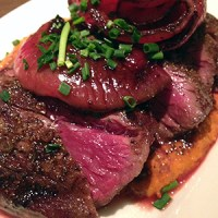 Skirt Steak with Romesco Sauce and Balsamic Roast Onions