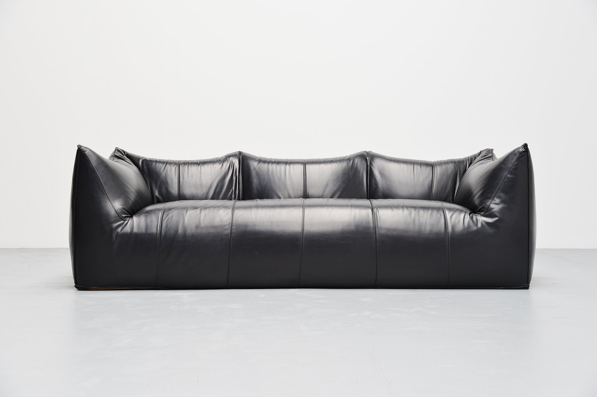tufted leather sofa edmonton give old new look mario bellini sectional