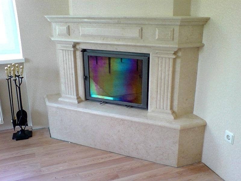 Fireplace from natural stone with furnace