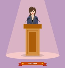 Woman standing behind a podium and speaking in public.