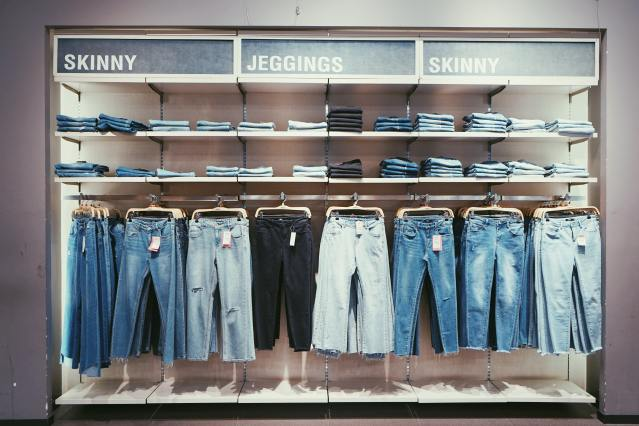 Blue and black jeans at a store display.