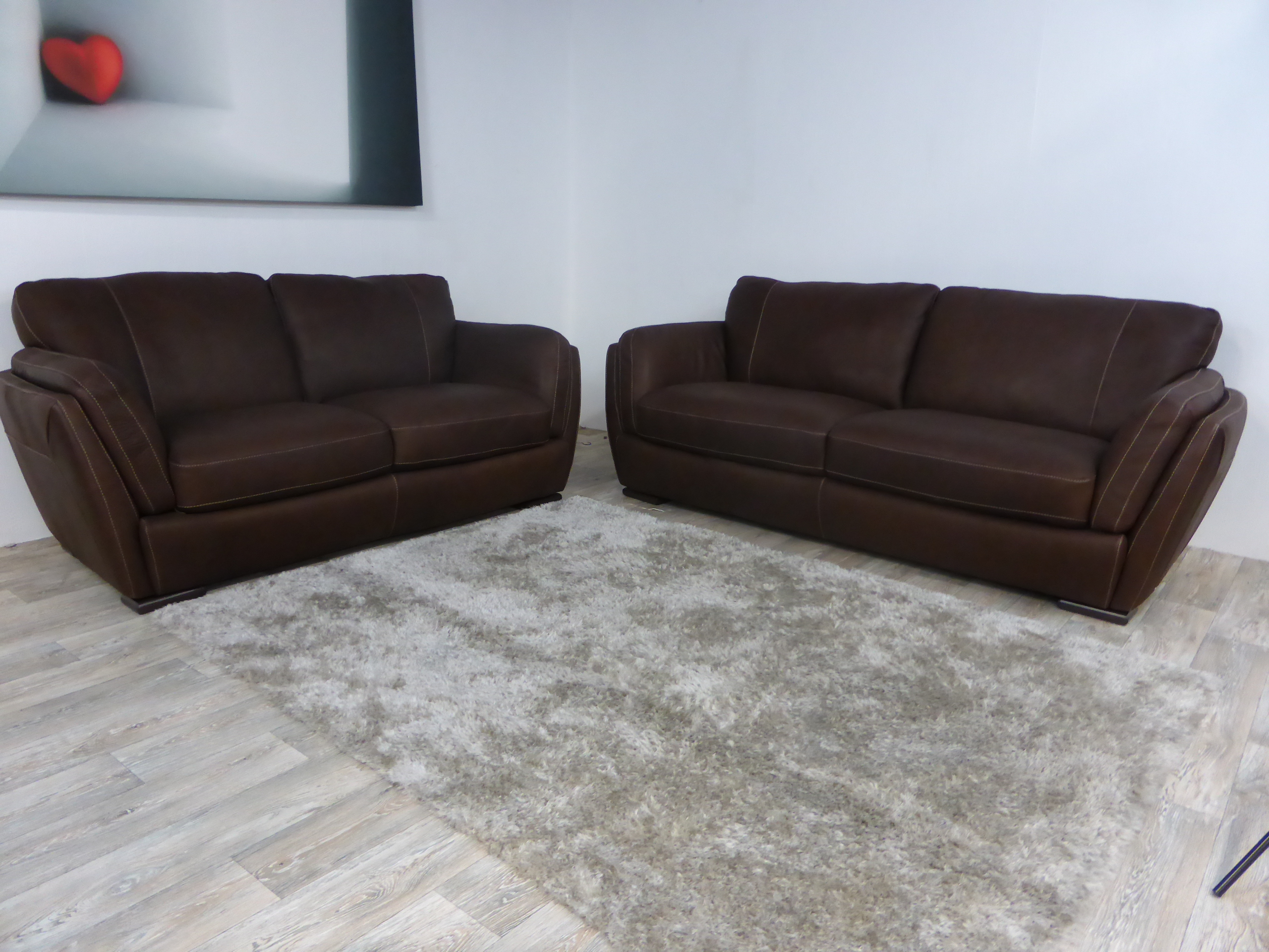 natuzzi arona 2 seater leather sofa bed and loveseat clearance editions havanna 3 sofas