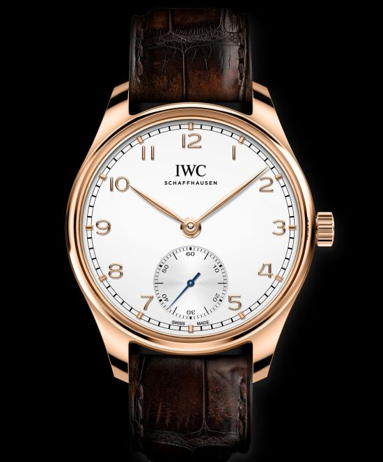 IWC Schaffhausen Portugieser Automatic 40, Ref. IW358306: 18-carat 5N gold case, silver-plated dial, gold-plated hands, 18-carat gold appliqués, brown alligator leather strap by Santoni.