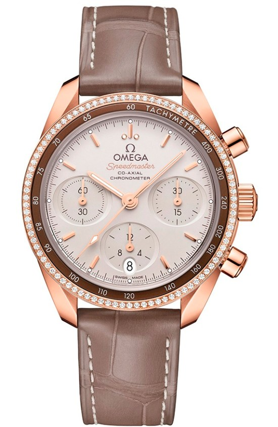 OMEGA Speedmaster 38 Co‑Axial Chronograph 38 mm, Ref. 324.68.38.50.02.003: Sedna™ gold model with creamy silvery dial, taupe-brown leather strap and diamond set bezel