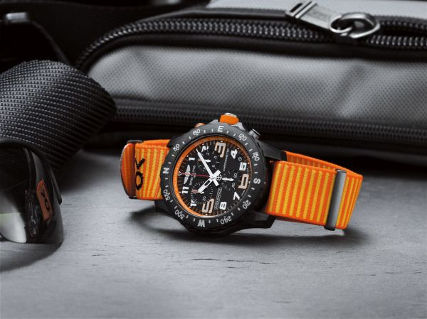 Breitling Endurance Pro with an orange inner bezel and Outerknown ECONYL® yarn NATO strap