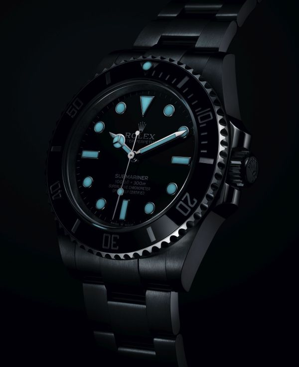 Rolex Oyster Perpetual Submariner in Oystersteel with a Black Cerachrom bezel and a black dial, 41mm, Reference 124060 lume shot