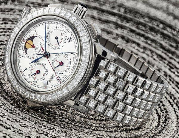 IWC 18k white gold and baguette-cut diamond-set limited edition minute repeating wristwatch with perpetual calendar, split seconds chronograph, tourbillon, moon phases and bracelet El Destriero Scafusia model, circa 1995. Price Realised: HK$3,250,000/ US$420,627 (4 times above its high estimate of HK$800,000/ US$103,539).