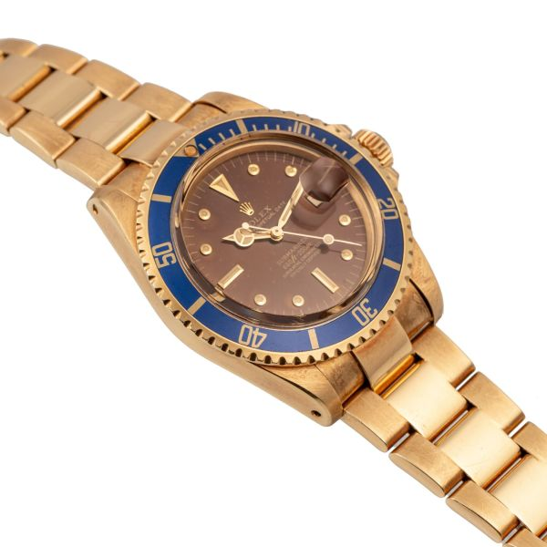"""LOT 224: Rolex, Ref.1680, Submariner, """"Arabic"""" Tropical Dial Full Set, Yellow Gold, Made For the UAE Armed Forces"""