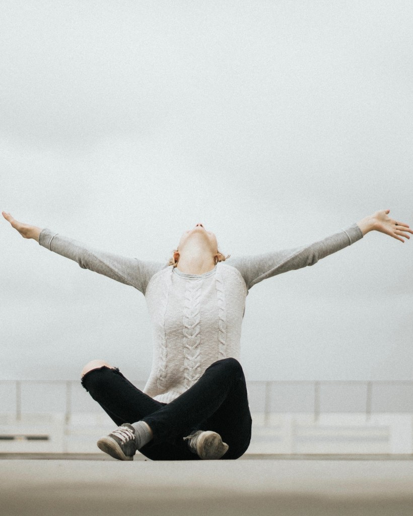 Joyful woman with arms outstretched
