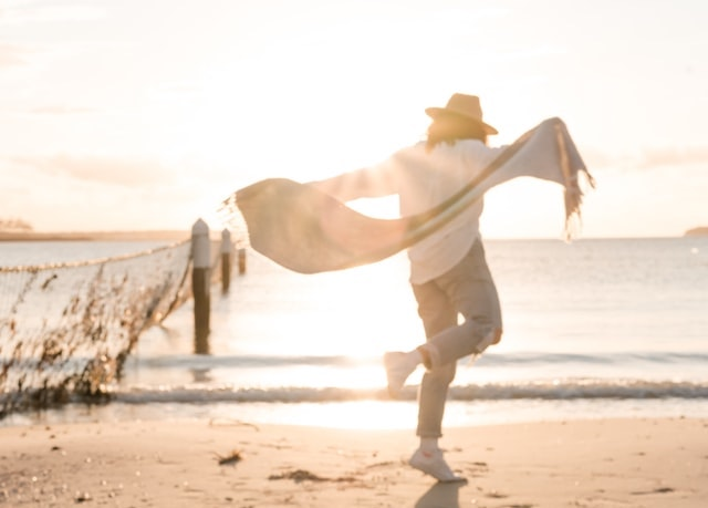 joyful woman at the coast by Kelli McClintock, from Unsplash.com