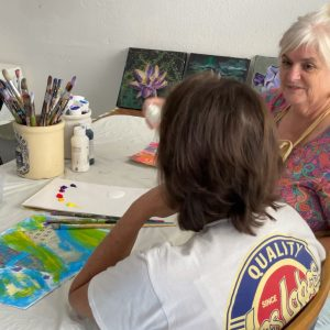 Christi with Painting Client
