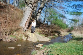 Ramona Hale bravely crosses the creek!
