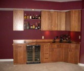 Custom bar with cherry hardwood construction made for entertaining guests.