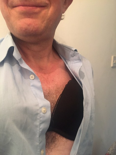 Master wearing a pale blue shirt with one of my bras peeking beneath. He looks suitably happy.
