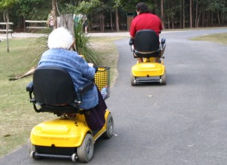 Old people on mobility scooters