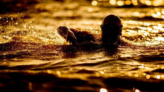 A person swimming at night time.