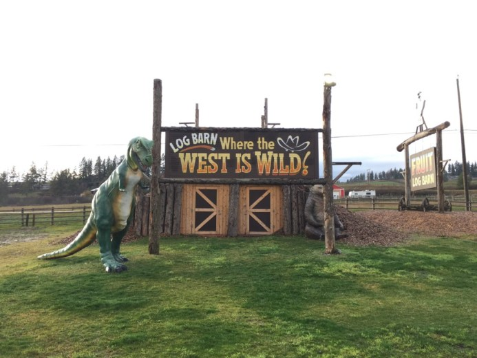 log barn 1912 wild west sign