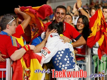 Spain's Brigitte Yague is congratulated after winning against Thailand's Chanatip Sonkham in their women's -49kg semifinal taekwondo match at the London Olympic Games