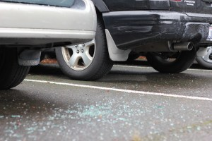 Broken glass lays on the ground in Yakima Lot on Friday afternoon after a series of early-morning car burglaries.