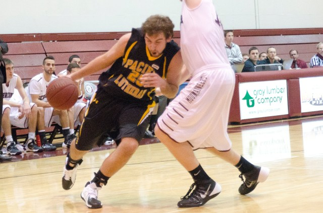 Junior Kevin McCrossin drives against a Mountaineer defender. McCrossin, a bench player, finished the game with one assist.