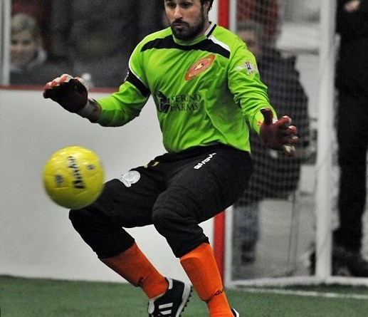 PLU alum Andrew Croft saves a ball during an indoor soccer match this year. Photo courtesy of Jeff Halstead.