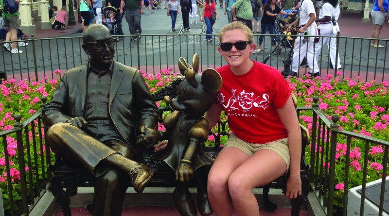 Sophomore Maddie Bernard sits next to the beloved Minnie Mouse and Roy Disney. In the background is Main Street USA, and Cinderella's Castle. In the castle you can get your makeup and hair done like a princess or prince, and then eat at the fancy restaurant inside.