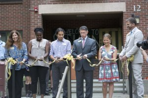 Left to Right: Vice President of Student Life and Dean of Students Joanna Royce-Davis, Resident Director Mercy Daramola, Resident Assistant Tyler Dobies, President Thomas Krise, Resident Hall Council President Mollie Parce and Dean of Campus Life and Executive Director of Residential Life Tom Huelsbeck  participate in cutting of the ribbon to freshly renovated Stuen Hall.