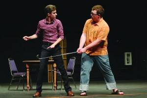 "First-years Jake Eliot and Dane Ostile-Olson engage in a golfing lesson in ""The Boys Next Door"" rehearsal."