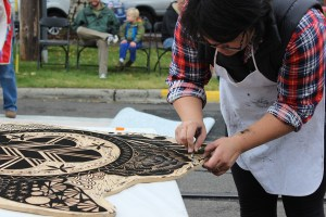 An artist makes some last minute touches to her block. Photo by Marra Clay.