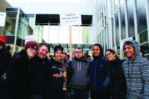 PLU students who attended the protest (left to right): Angela Tinker (junior), Dan Stell (senior), and first-years Quenessa Long, Tono Sablan and Ray Taula. Two students from Stadium High School joined the photo as well. Photo by Angie Tinker