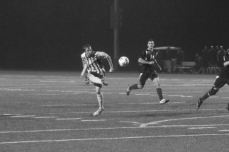 PHOTO BY BAILEY PLUMB: Senior Jordan Downing (16) looks to lead his forward with PLU on the attack.