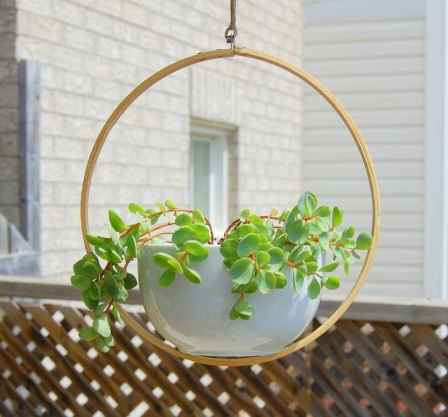 Charming outdoor hanging planters ideas to brighten your yard 06