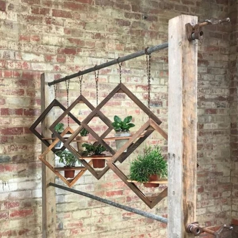 Charming outdoor hanging planters ideas to brighten your yard 23