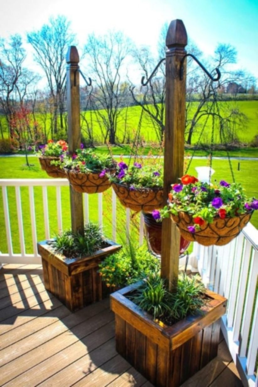Charming outdoor hanging planters ideas to brighten your yard 38