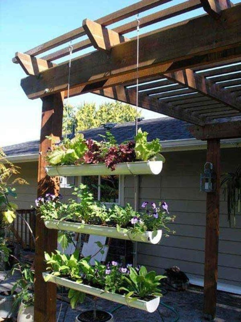 Charming outdoor hanging planters ideas to brighten your yard 42