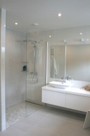 Nice and minimalist bathroom with the glass wall with a concrete 01