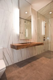 Nice and minimalist bathroom with the glass wall with a concrete 05