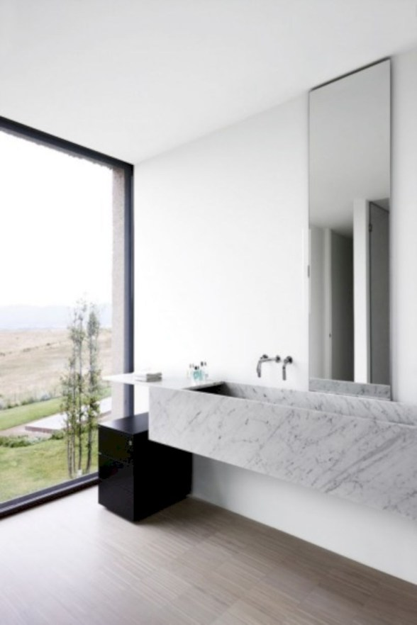 Nice and minimalist bathroom with the glass wall with a concrete 07