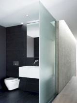 Nice and minimalist bathroom with the glass wall with a concrete 08