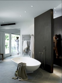 Nice and minimalist bathroom with the glass wall with a concrete 10
