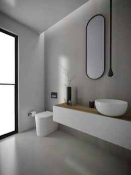 Nice and minimalist bathroom with the glass wall with a concrete 12